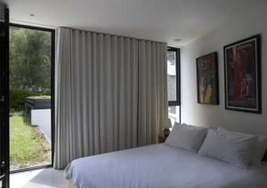 wave curtains on floor to ceiling bedroom
